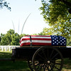 "The caisson, bearing the casket of Col. Clem Robert ""Bob"" Lawson USAF, passes in front of the Air Force Memorial, Arlington National Cemetery, July 8, 2009"